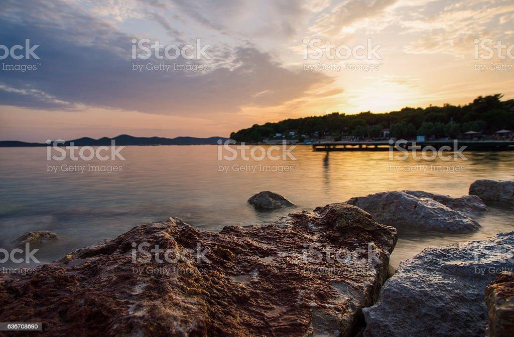 Long exposure image of sea at Pakostane in Croatia sunset stock photo