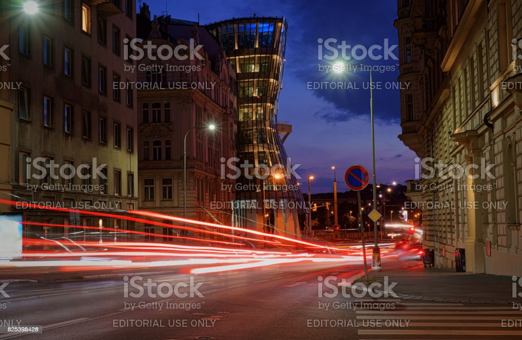 Long exposure image of traffic light and the modern architecture 'Dancing House' stock photo