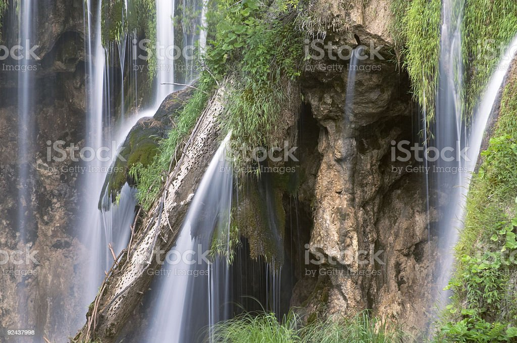 Long exposure image of waterfall and withered trunk in Plitvice royalty-free stock photo