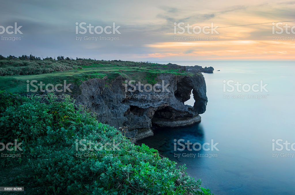 Long exposure, Manzamo in sunset, Summer, Okinawa, Japan stock photo