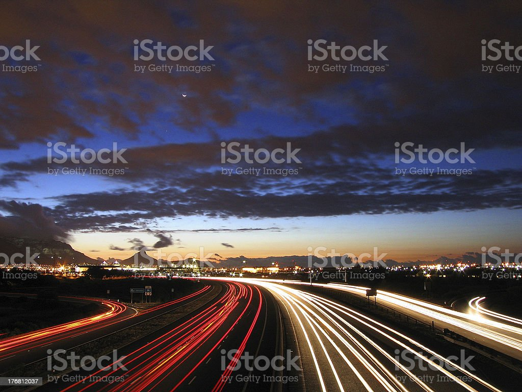 Long exposure of a busy city highway at twilight. stock photo