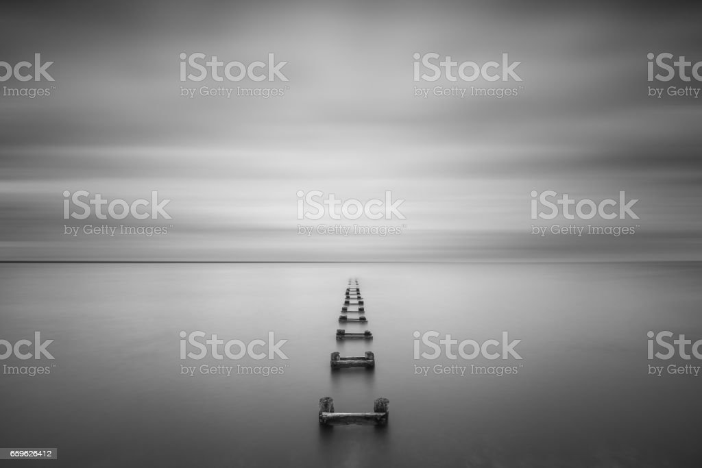 Long exposure of a pipe leading into the bay stock photo