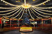 Long exposure of blurry light carousel, Christmas fair, Cologne, Germany