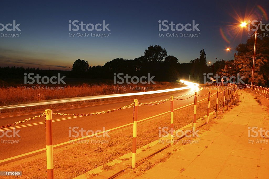 Long exposure of cars lights on road at night stock photo