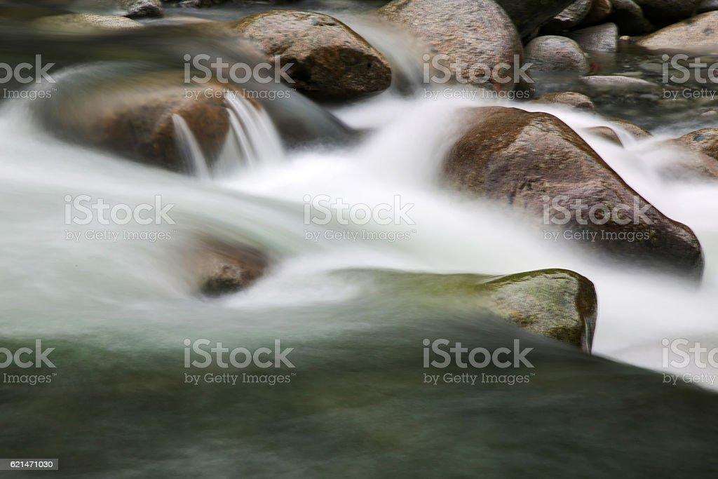 long exposure of creek water stock photo