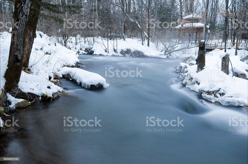 Long exposure of foggy winter river, Mojie Scenic Area, China stock photo