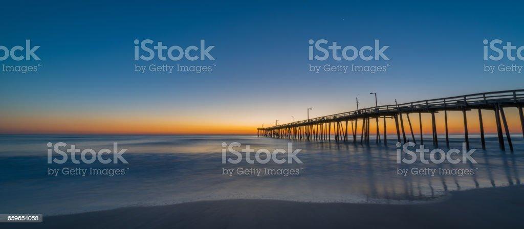 Long exposure of Nags Head Pier at sunrise stock photo