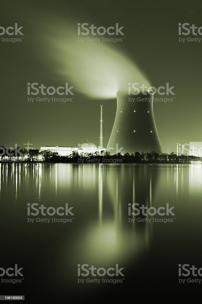 Long Exposure of Nuclear Power Plant at Night, Toned stock photo