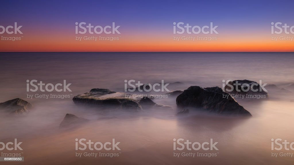 Long exposure of ocean rocks stock photo