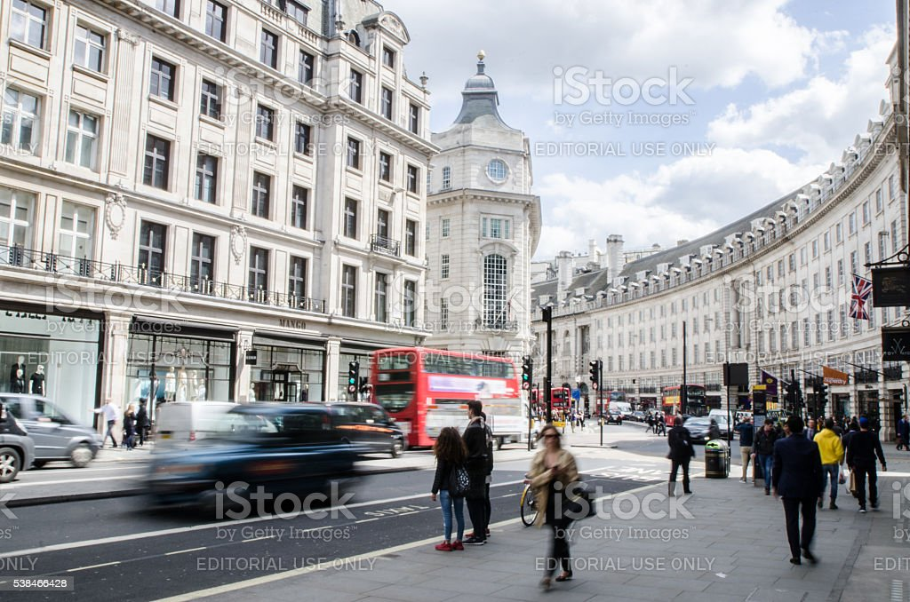 Long exposure of people and cars passing by Regent Street stock photo