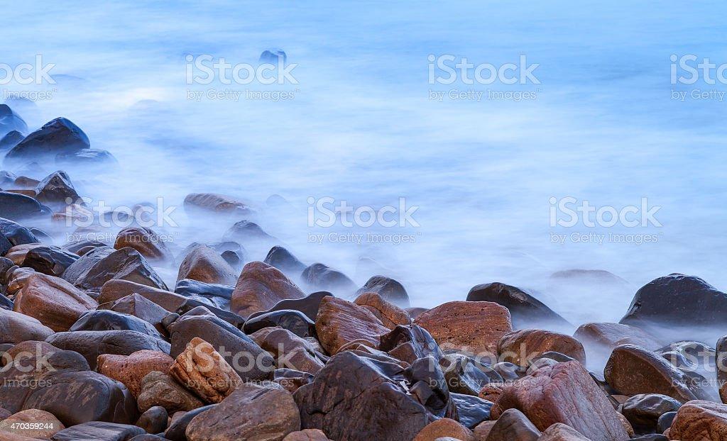 Long exposure of rocks and sea stock photo