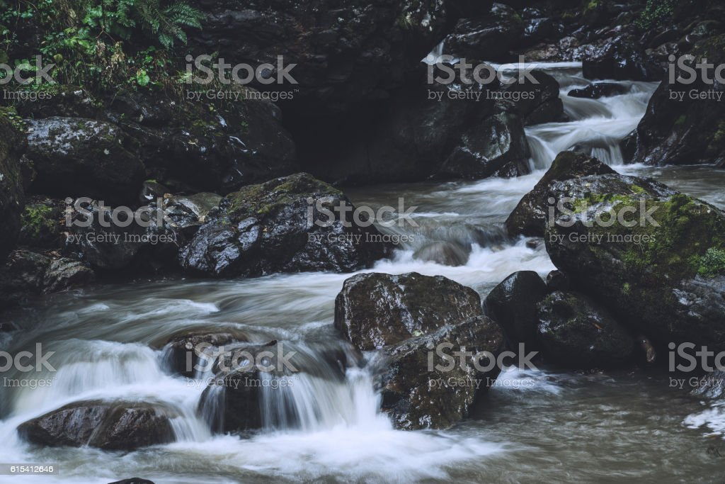 Long exposure of running river down the rocks stock photo
