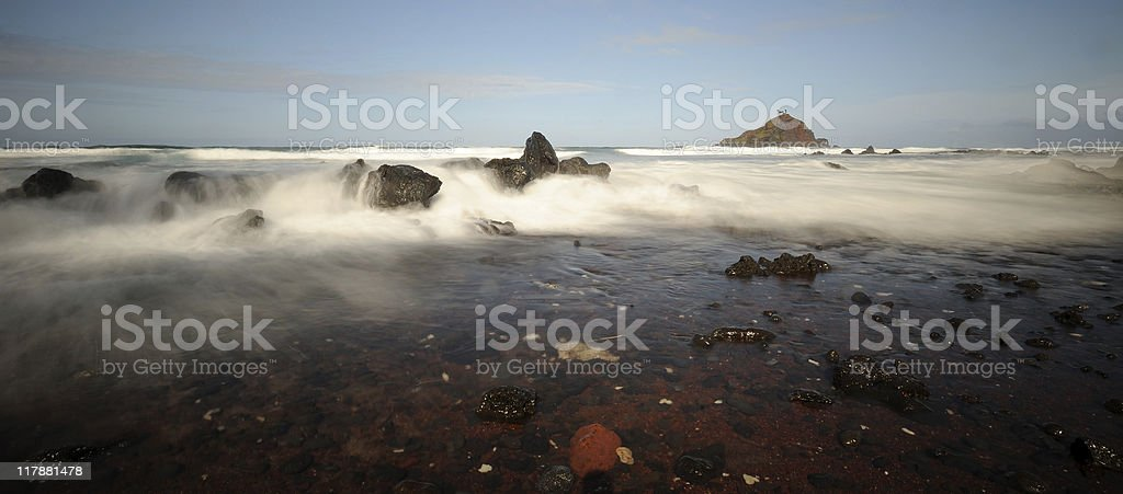 Long Exposure of Surf On Rocky Coastline stock photo