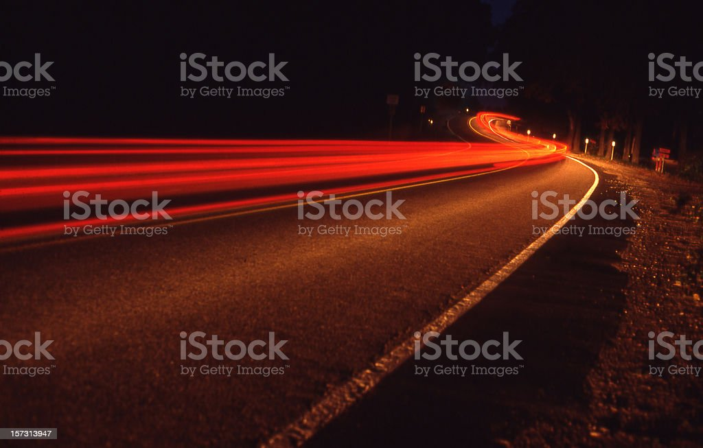 Long exposure of tail lights on a road. royalty-free stock photo