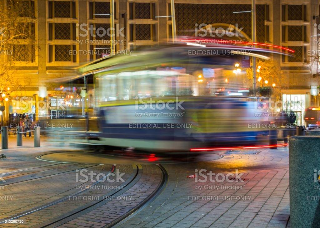 Long Exposure of tram turning in San Francisco stock photo