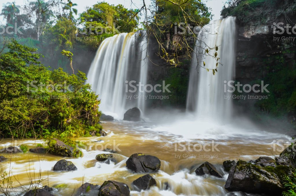 A long exposure photo of a small waterfall pertaining to Iguazu Falls with wet stones. Photo taken on the Argentina side. stock photo