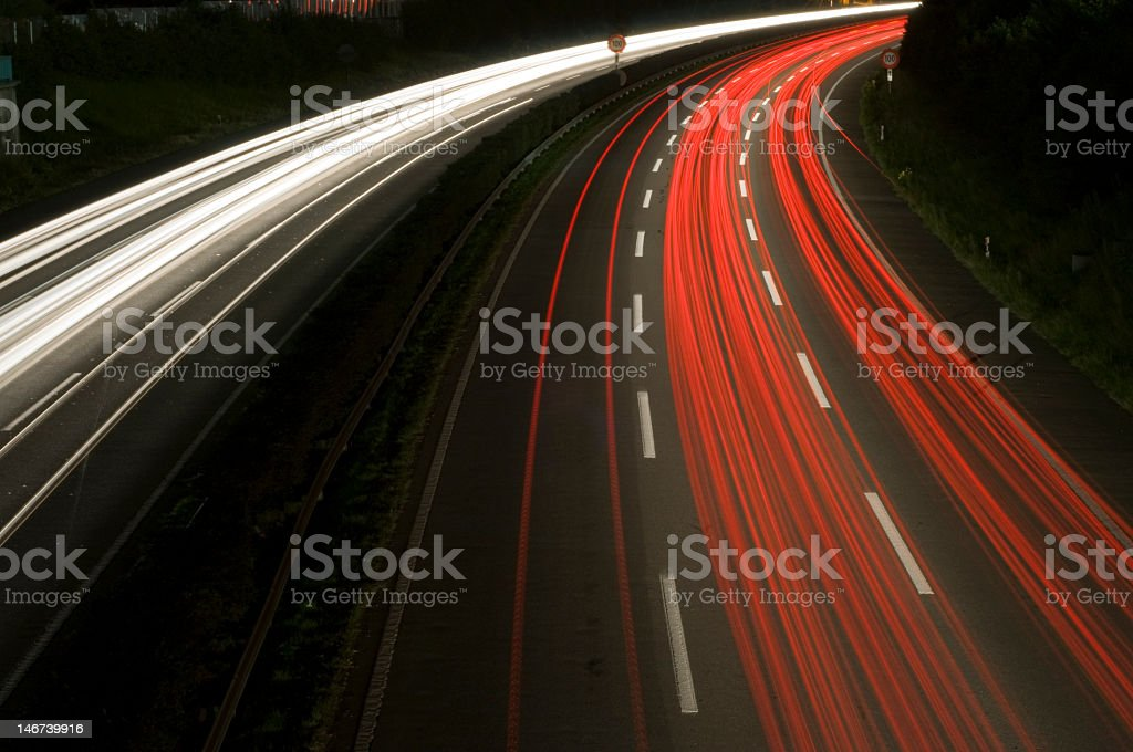 Long exposure photograph of a highway curve royalty-free stock photo