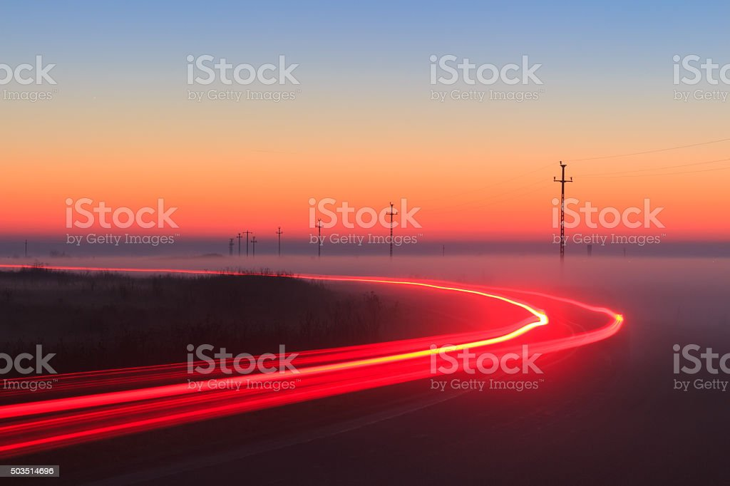 Long Exposure Red Car light trails on a road stock photo