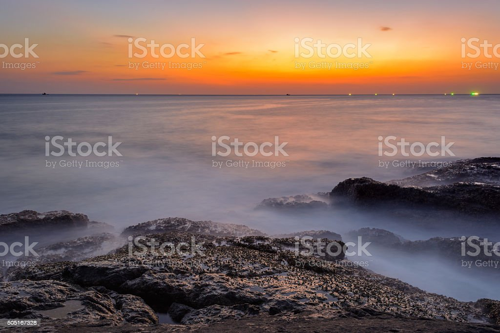 Long exposure seascape during blue hour sunset stock photo