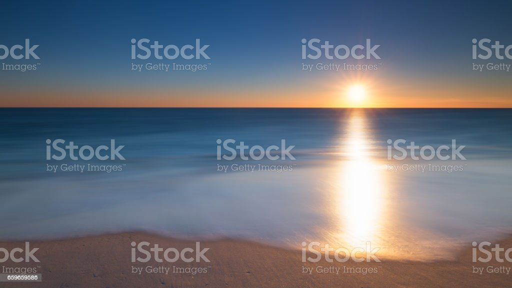Long exposure seascape sunrise stock photo