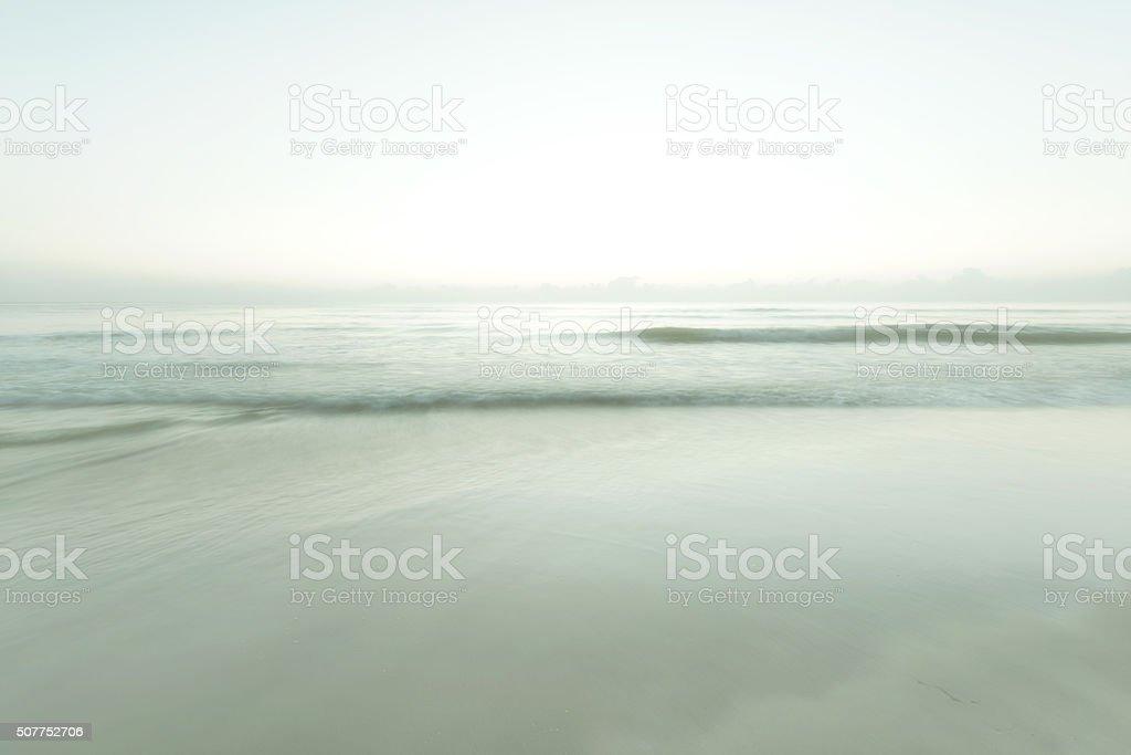 Long exposure shot at the Hua Hin Beach during sunrise stock photo