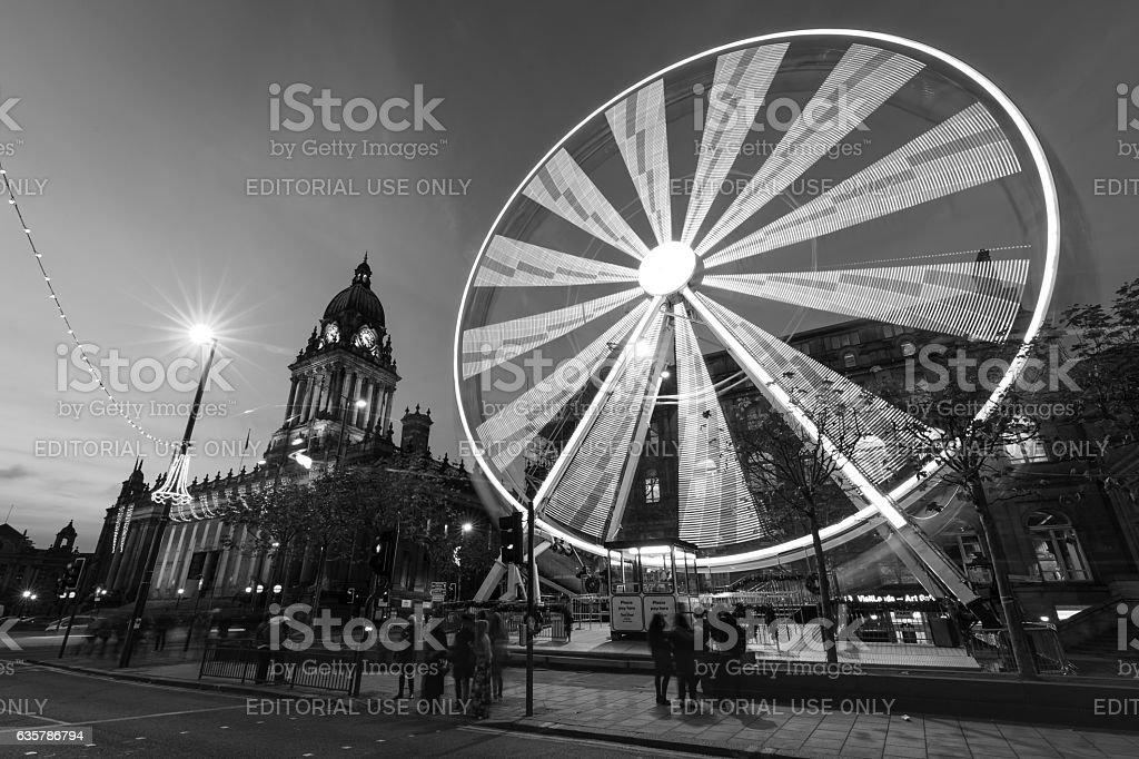 Long exposure shot of Leeds Town Hall and Ferris Wheel stock photo