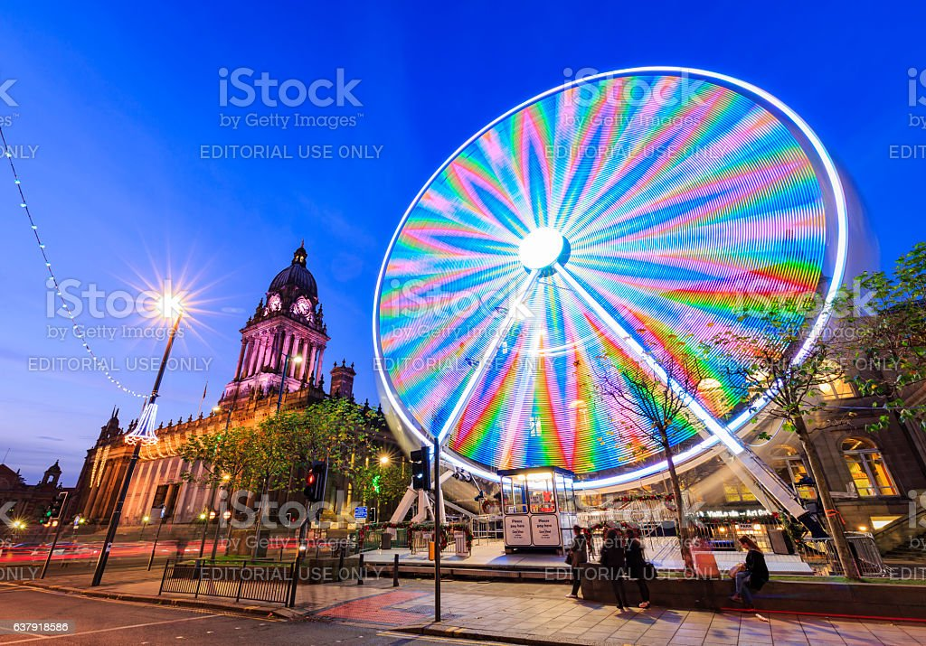 Long exposure shot of Leeds Town Hall and Ferris Wheel stock photo