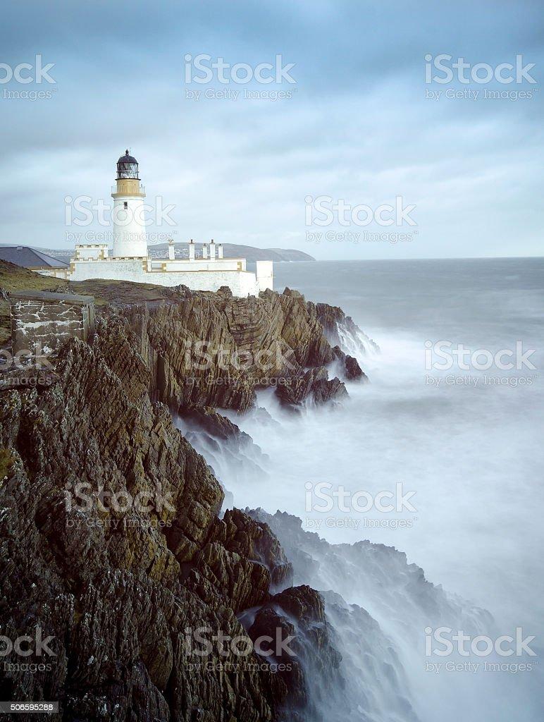 Long Exposure Storm Sea Lighthouse Cliffs stock photo