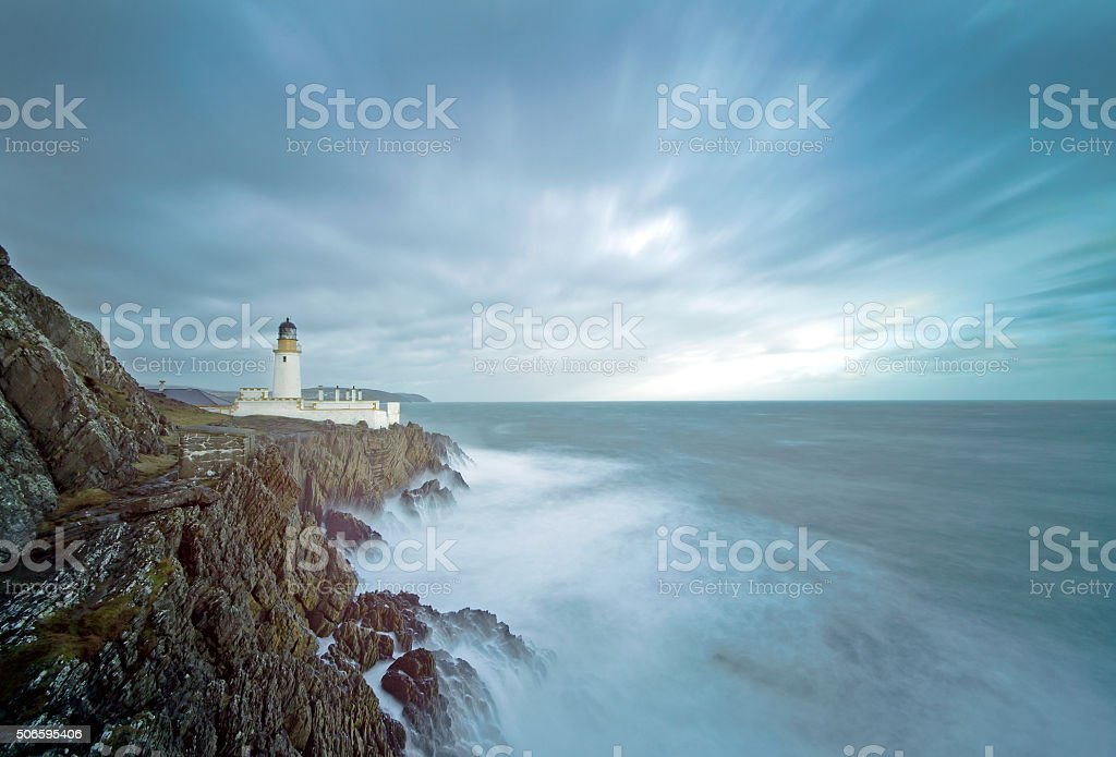Long Exposure Storm Sea Lighthouse Cliffs stock photo