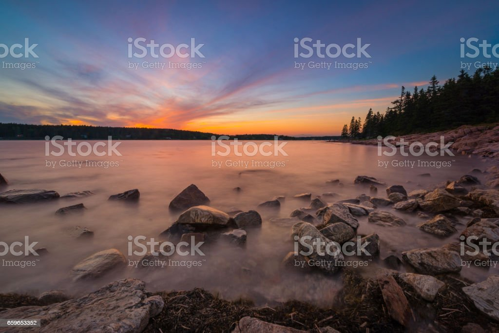 Long exposure sunset along Maine's coastline. stock photo