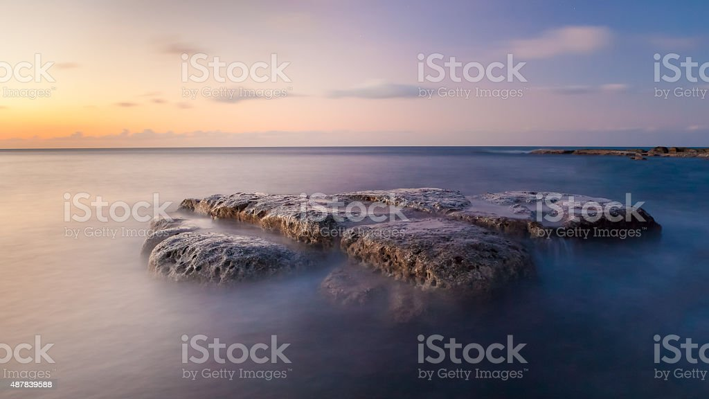 Long exposure waterscape and rock stock photo