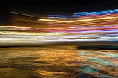 Long Exposured Abstract Colorful Lights Background with Water Surface