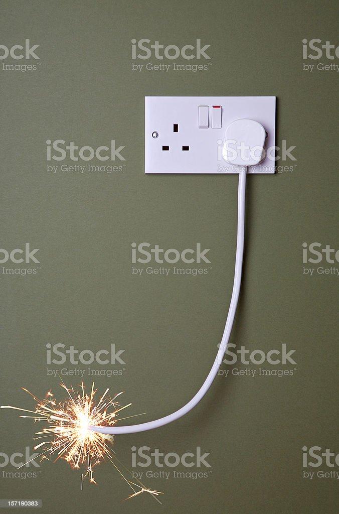 Long fuse burning towards plug socket. royalty-free stock photo