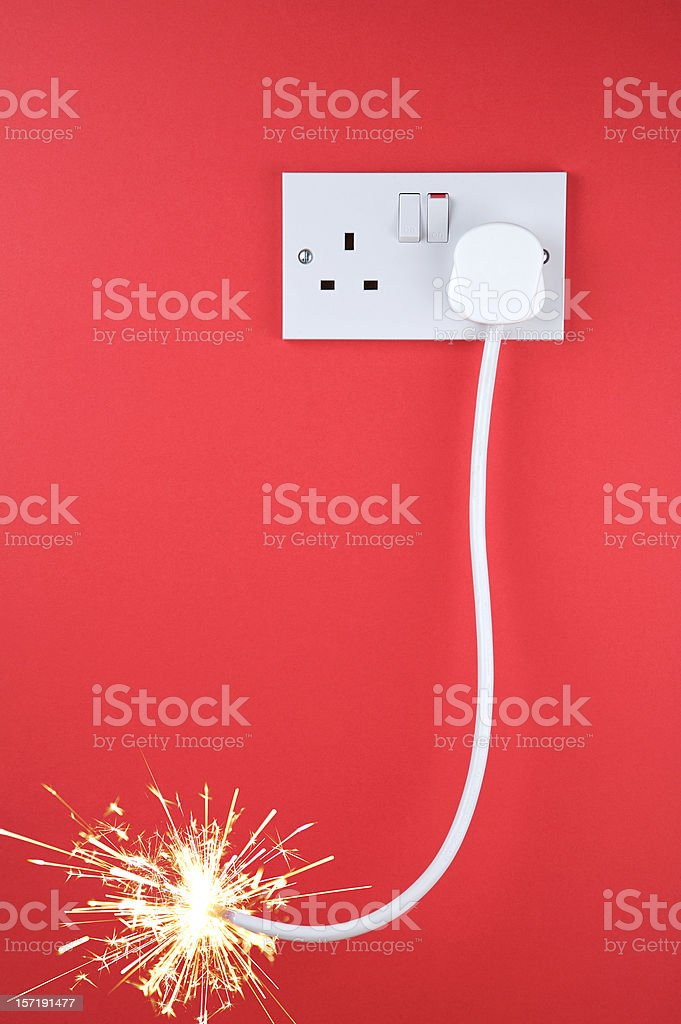 Long fuse burning towards plug socket royalty-free stock photo
