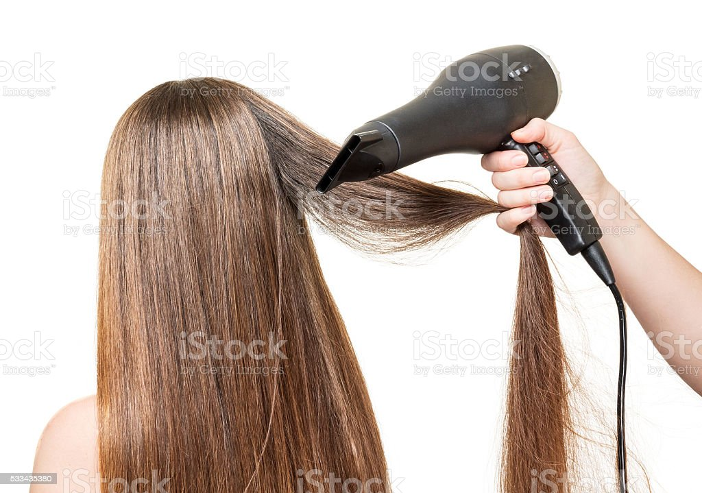 Long  hair, and hair dryer in  hand isolated on white stock photo