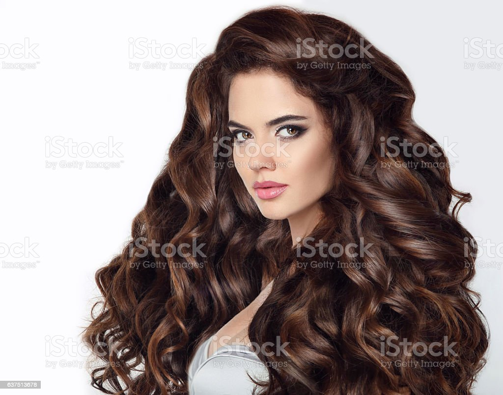 Long hair. Beautiful brunette woman portrait with curly shiny hairstyle stock photo