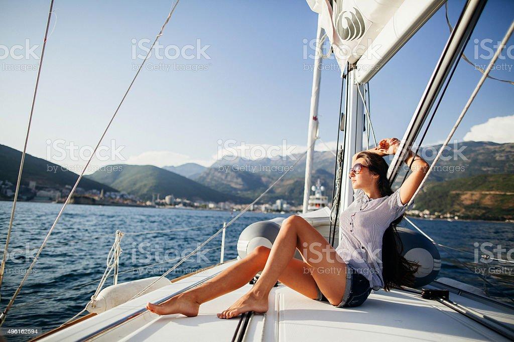 long hair girl on yacht in Montenegro stock photo