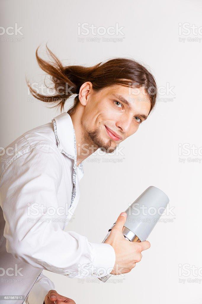 Long haired barman shaking head. stock photo