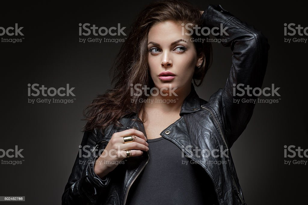 Long haired brunette female wearing casual street clothes stock photo