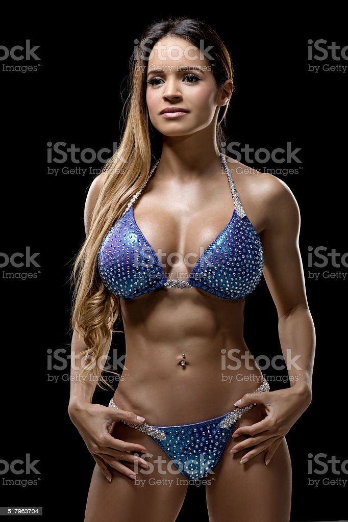 Long haired female bikini athlete posing stock photo