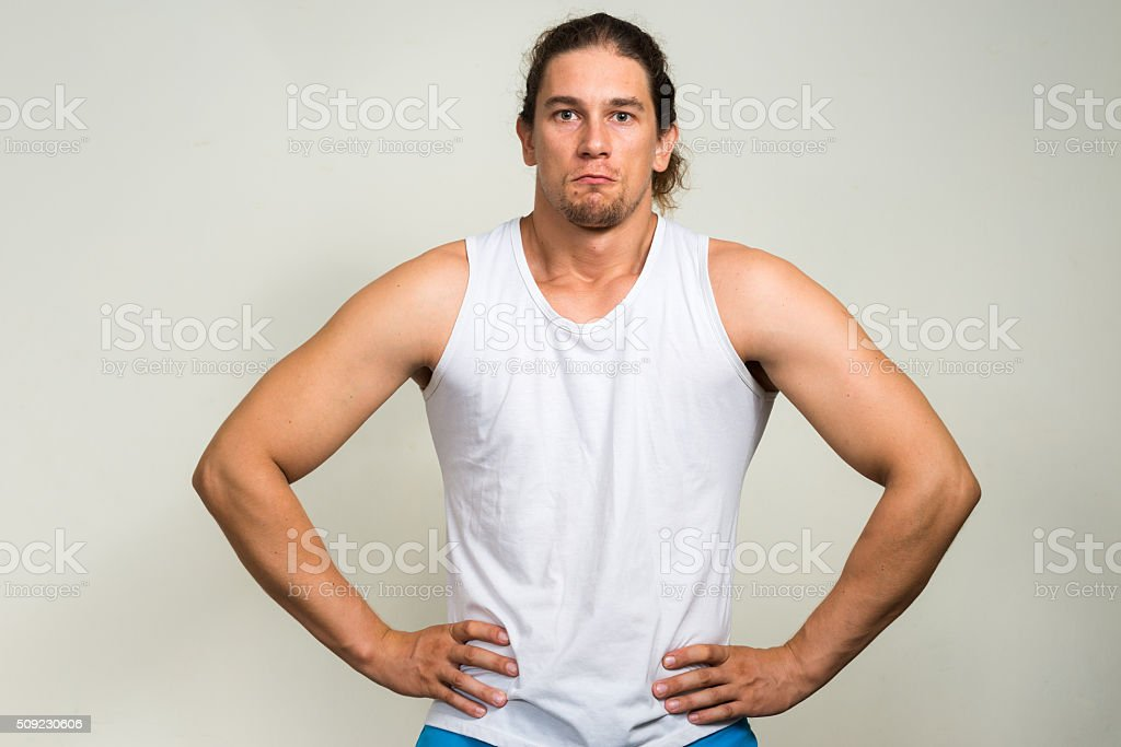 Long haired fitness man stock photo