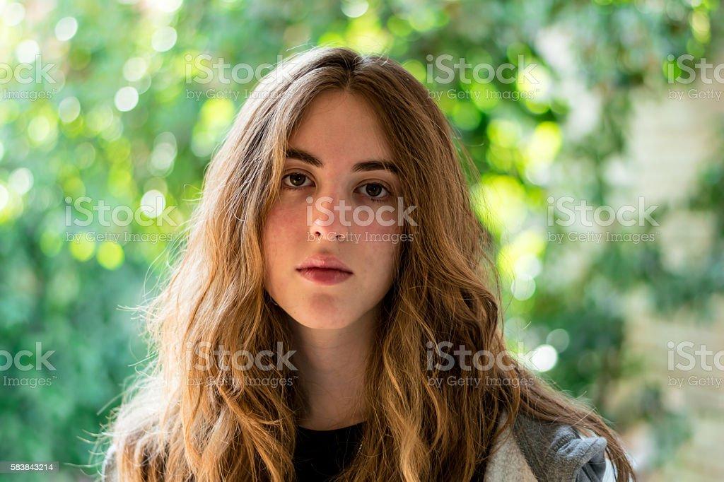 Long haired teenage girl facing the camera stock photo