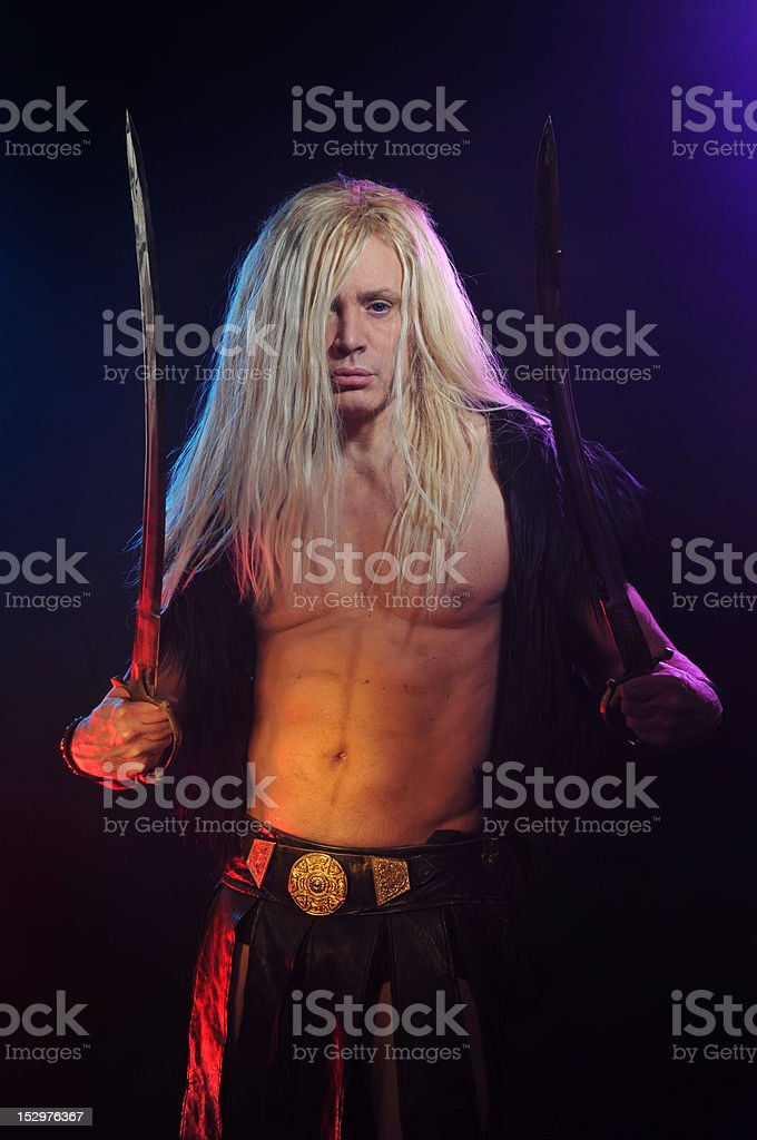 Long haired viking warrior with two swords stock photo