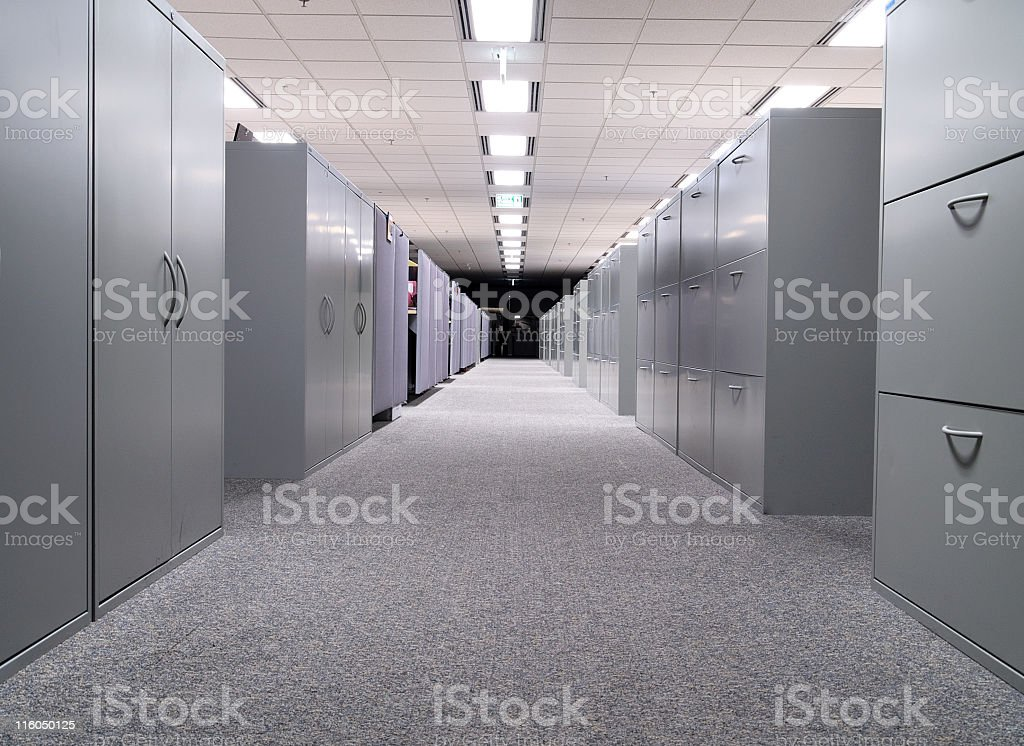 Long hall with grey file cabinets on both sides stock photo