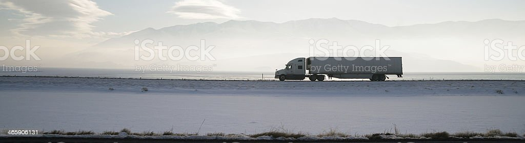 Long Haul Trucker White Light Polution Salt Flats Utah Highway stock photo