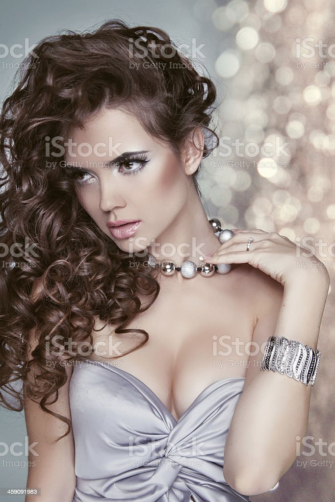 Long healthy hair. Glamour Fashion Woman Portrait over bokeh stock photo