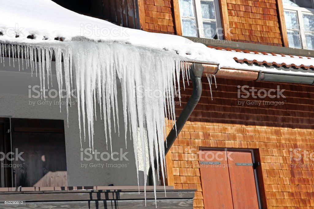 Long icicles at a house stock photo