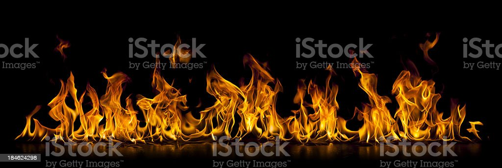 Long isolated wall of burning fire flame stock photo