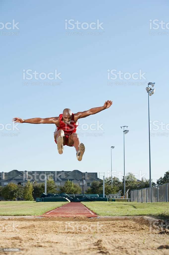 Long jumper in air stock photo