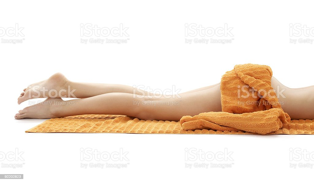 long legs of relaxed lady with orange towel #3 royalty-free stock photo